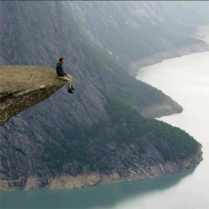 sitting-at-the-edge-of-a-cliff
